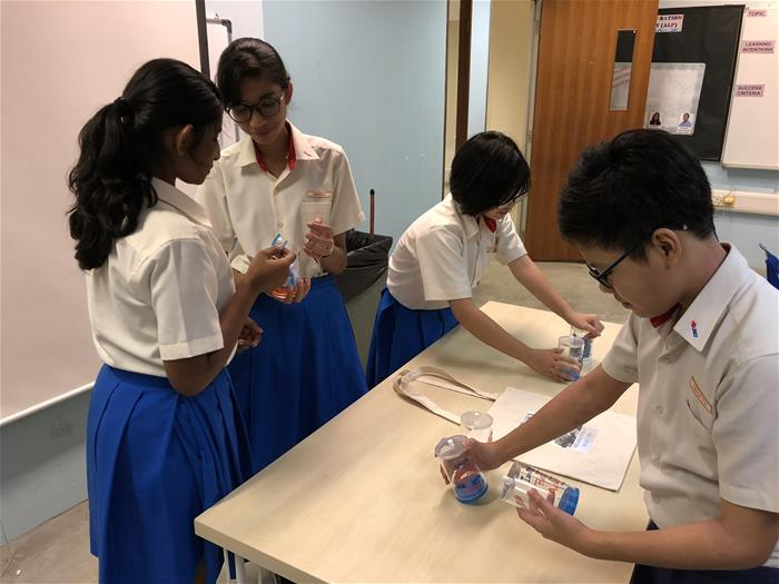 Students preparing their sales items at Regent Secondary School